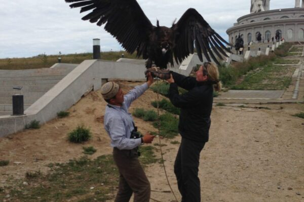Holding-a-vulture-in-Mongolia-1-scaled