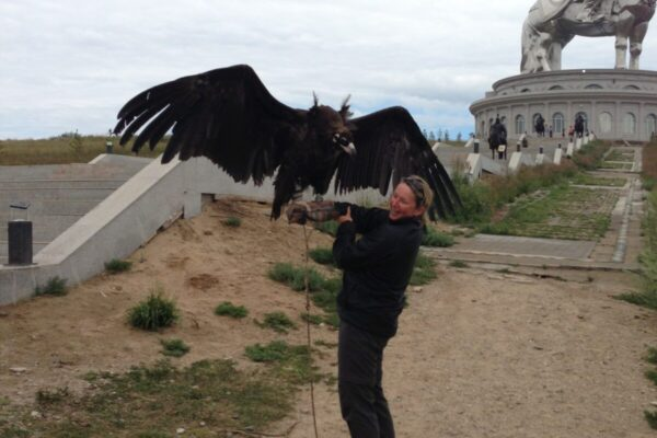 Holding-a-vulture-in-Mongolia-2-scaled